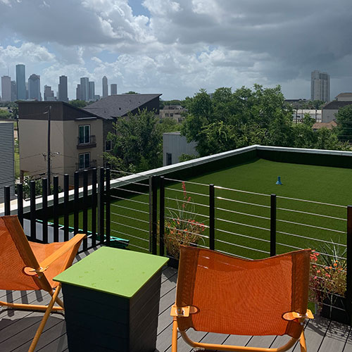 synlawn artificial turf with orange chairs and a view